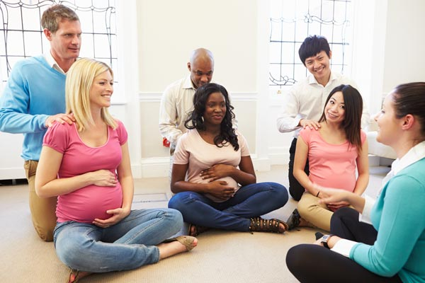 Three couples attending a birth class